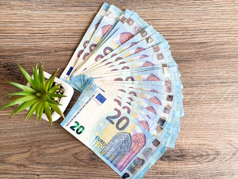 Banknotes with a nominal value of twenty Euro lying like a fan on the table.  royalty free stock photography