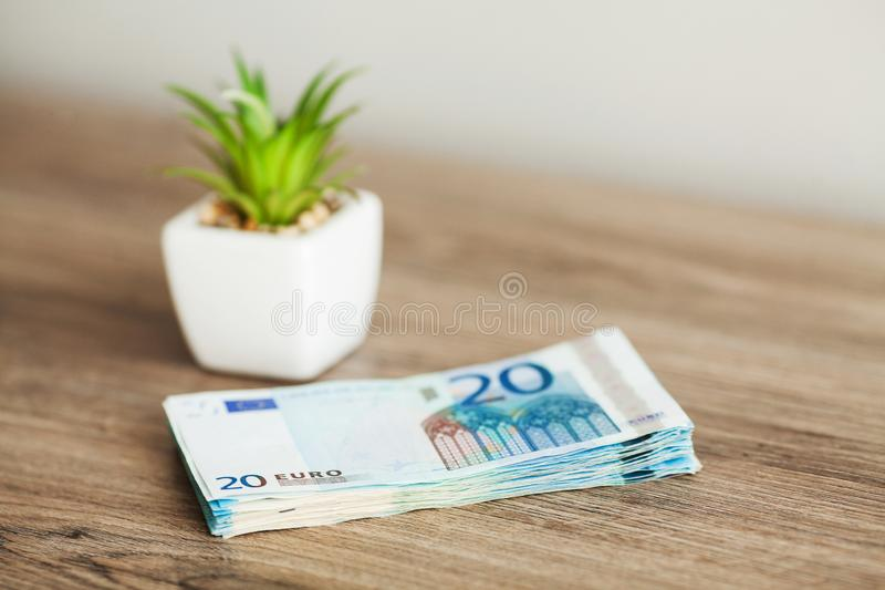 Banknotes with a nominal value of twenty Euro lying like a fan on the table.  stock images