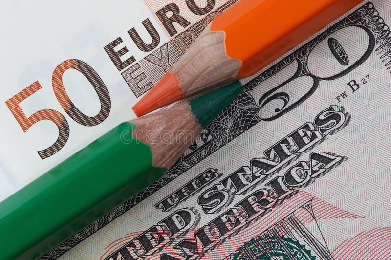Banknotes and pencils stock images
