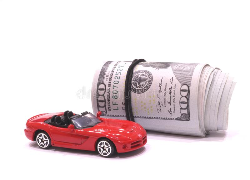 Banknotes and a red sports car. One hundred dollars banknotes and a red sports car stock images