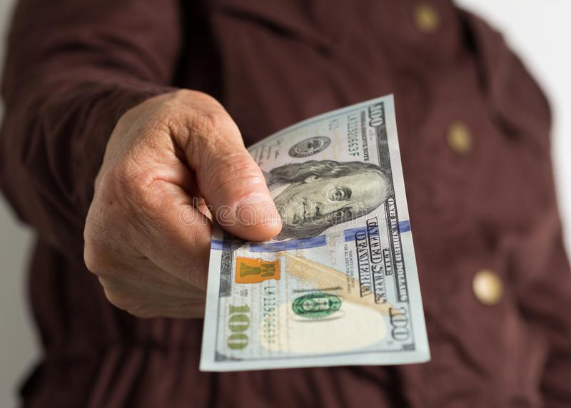 Banknotes of USA currency: Dollar. Old retired person paying in cash stock image