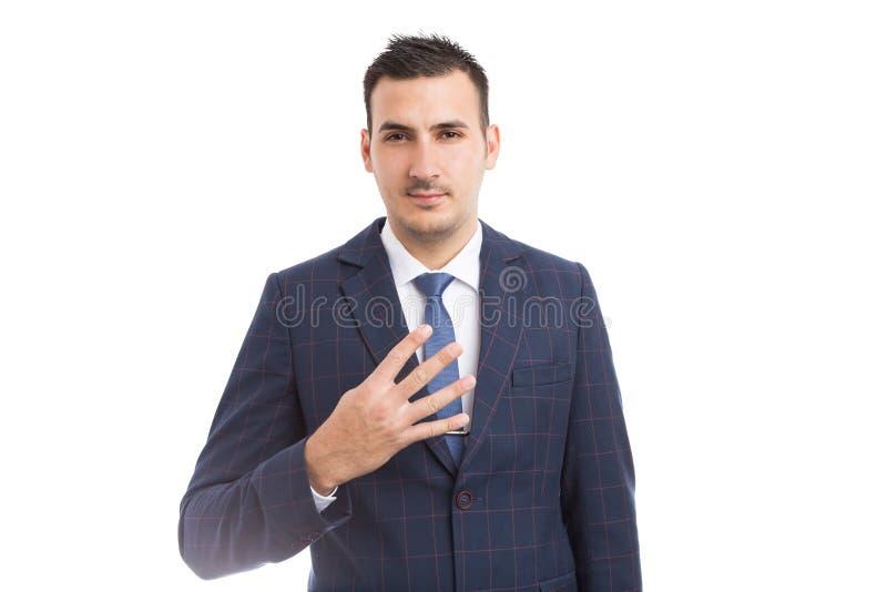 Bankowa biznesmena lub maklera seans liczba cztery z palcami obraz stock