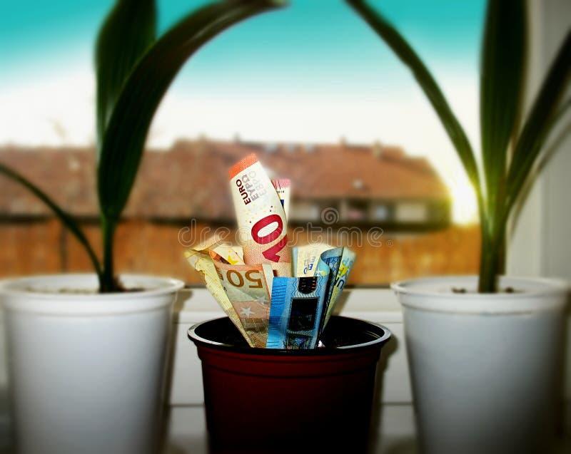 bankowości pojęcia domu pieniądze garnek zdjęcia royalty free