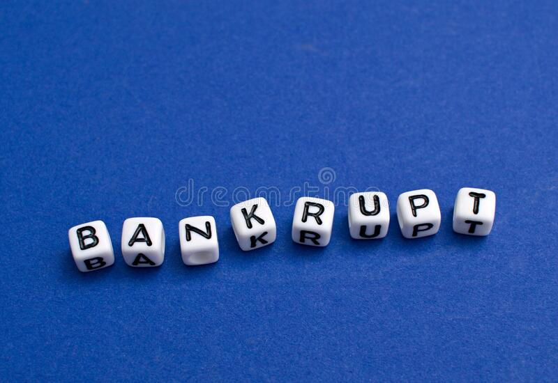 Lettering Bankrupt. Bankrupt - letters arranged in front of blue background royalty free stock photos