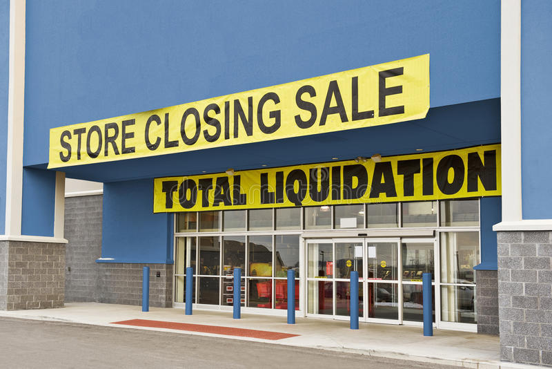 Bankrupt Retail Store Revised (1). A blue retail store having a liquidation sale royalty free stock photography