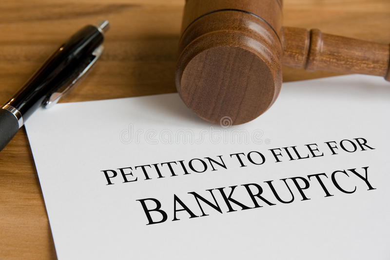 Bankruptcy. Concept with judge's wooden gavel and petition notice