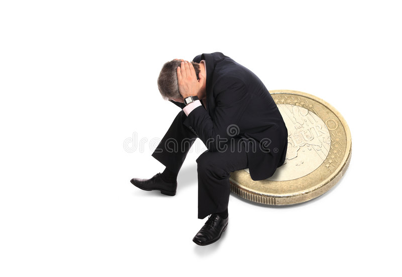 Bankruptcy. Bankrupted businessman sitting on an coin isolated on white background stock photography