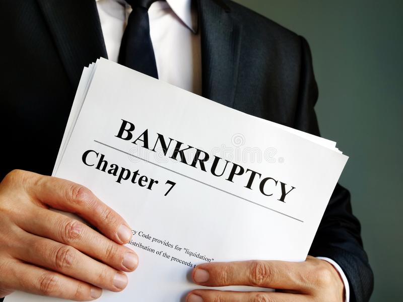 Bankruptcy Chapter 7 documents in the hands royalty free stock photography