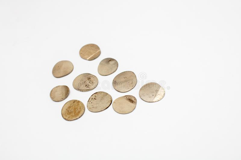 Bankruptcy concept , Pressed coins close up,. Top view on white background stock photography