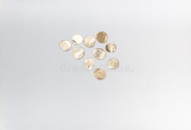 Bankruptcy concept , Pressed coins close up,. Top view on white background royalty free stock image