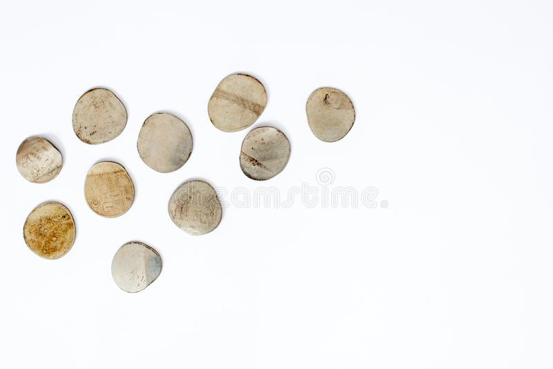 Bankruptcy concept , Pressed coins close up,. Top view on white background royalty free stock images