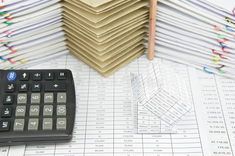 Bankruptcy of house and calculator on finance account. Have pencil place vertical at pile of envelope between paperwork as background stock photography