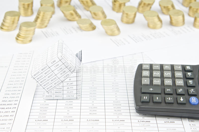 Bankruptcy of house have pile of gold coins as background. Bankruptcy of house with calculator have pile of gold coins on finance account as background stock images