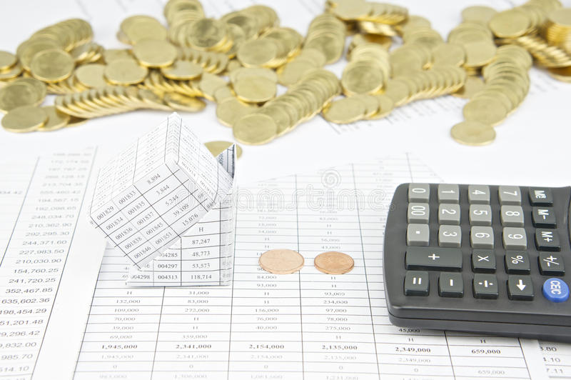 Bankruptcy of house have stack of gold coins as background. Bankruptcy of house with calculator have stack of gold coins on finance account as background stock photo