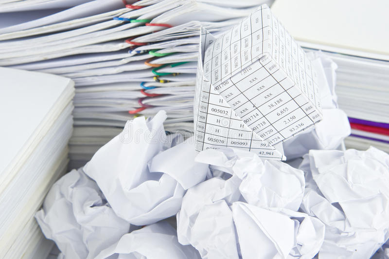 Bankruptcy of house on pile of paper ball. Have pile of paperwork as background stock images
