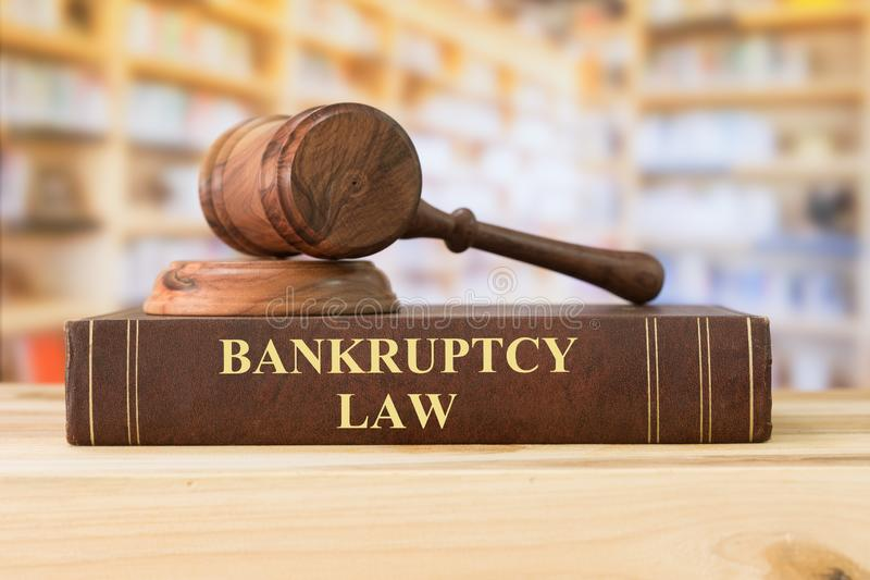 Bankruptcy law. Books with a judges gavel on desk in the library. Concept of ,bankrupt,bankruptcy court,law education ,law books royalty free stock image