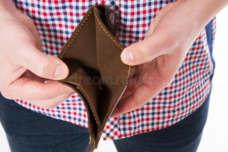 Bankruptcy - Male Person holding an empty wallet, hand holding Empty Wallet royalty free stock photo