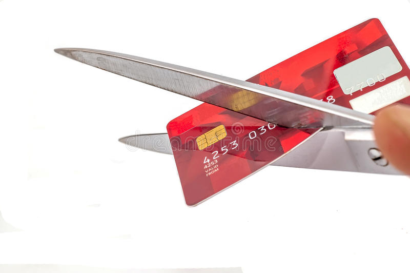 Bankruptcy. Photo of scissors cutting old credit card on white background, SOFT FOCUS stock photography