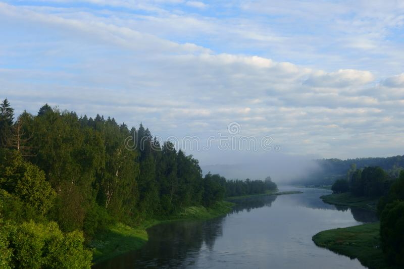 Banks of Moskva river illuminated by the sunrise. Mars village near Moscow, Russia - JUNE 17, 2019: The picturesque winding banks of the Moscow River illuminated stock photos