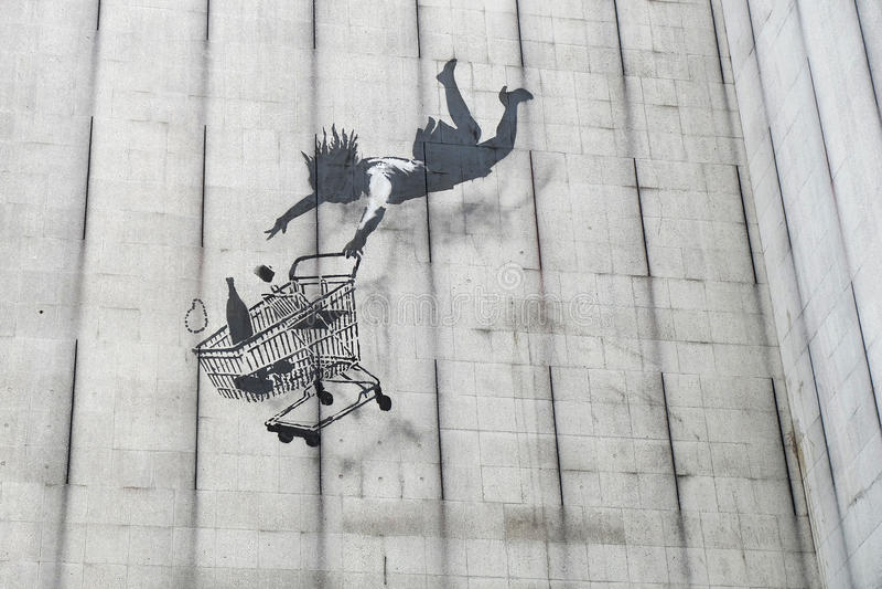 Banksy kupującego spada graffiti zdjęcie royalty free