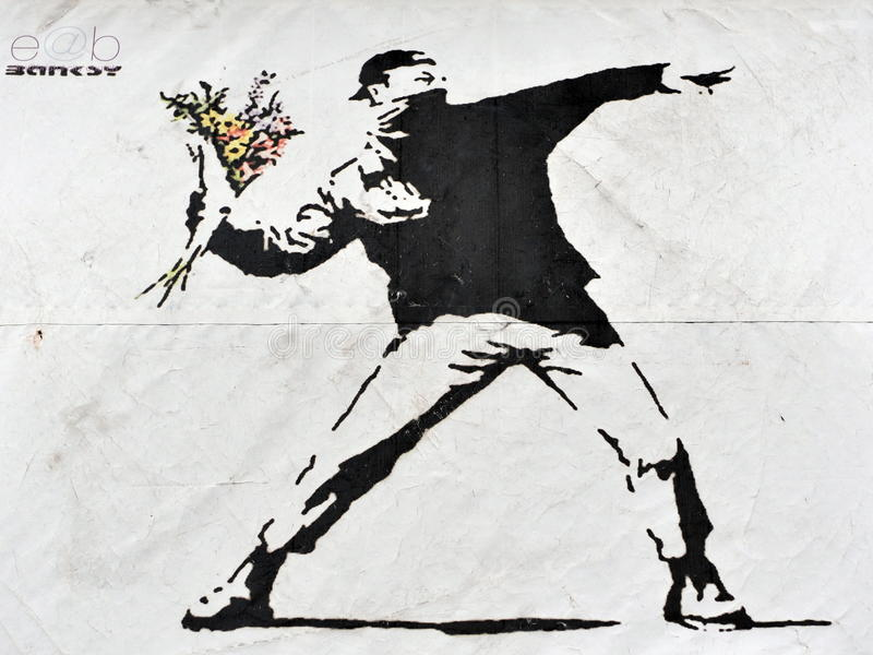 Banksy Street Art. View of a famous Banksy graffiti piece promoting an art show at Elim Church on September 21, 2012 in Bristol, UK. Bristol is renowned for it's stock image