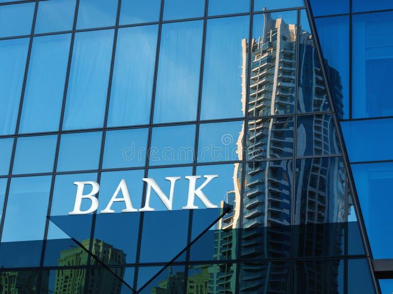 Bankteken op glas blauwe muur royalty-vrije stock afbeelding