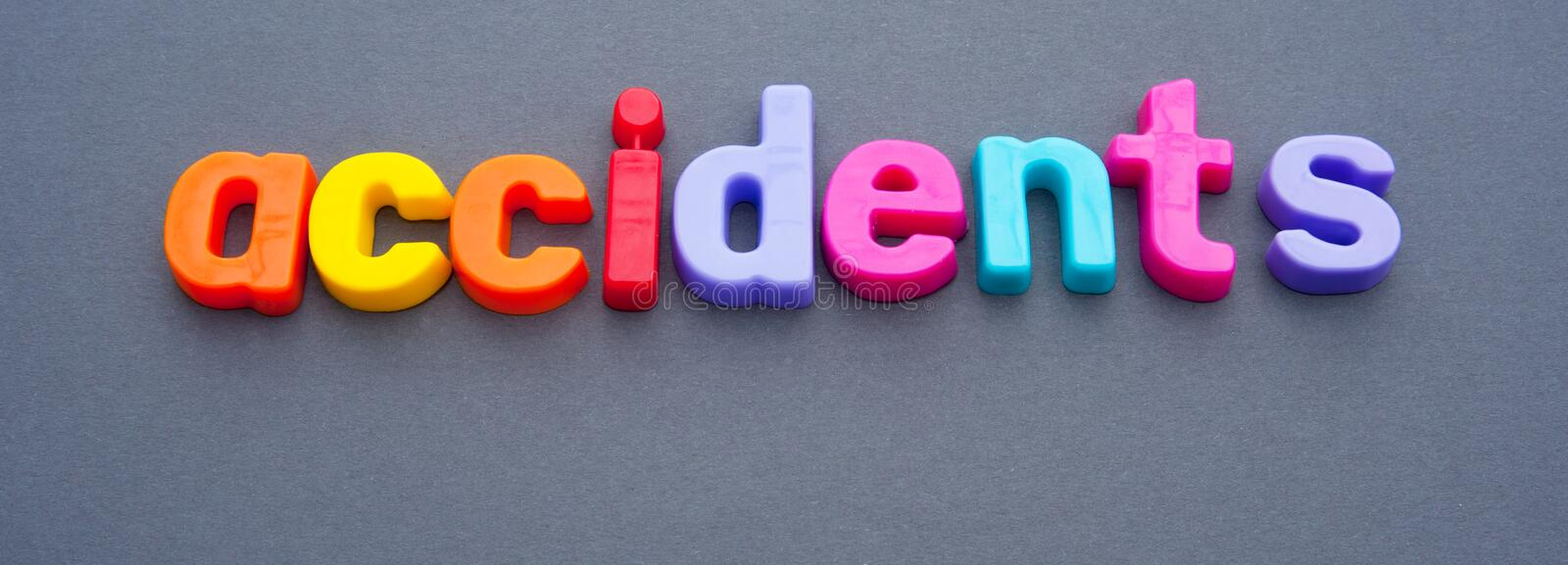 Banner: accidents. Text ' accidents ' in colorful lowercase letters, dark background royalty free stock photo
