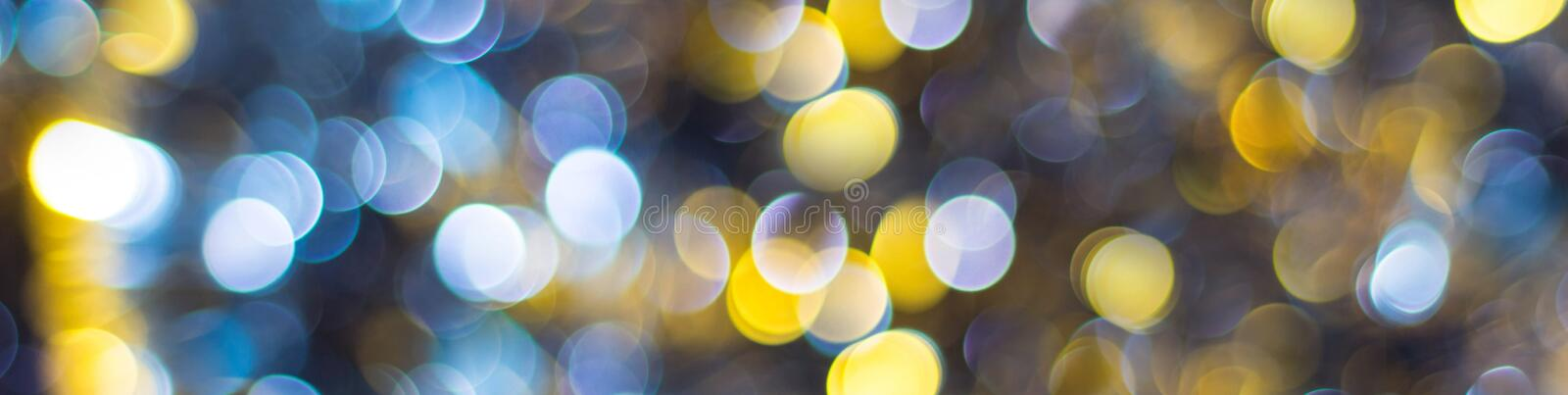 banner of Blue Yellow White bokeh. Christmas background texture royalty free stock photography