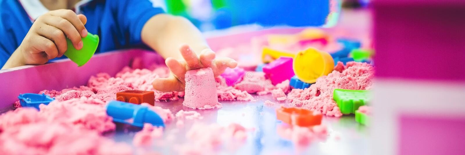 BANNER Boy playing with kinetic sand in preschool. The development of fine motor concept. Creativity Game concept. Long Format.  royalty free stock image