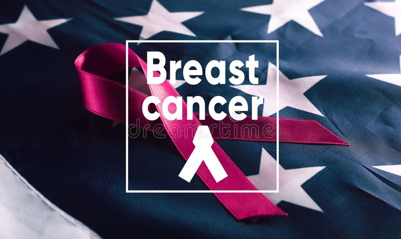 Banner breast Cancer. Pink ribbon symbol on American flag background stock photography
