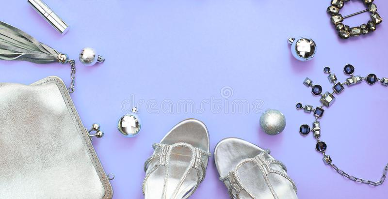 Banner Christmas Set of fashion accessories flat lay shoes handbag necklace jewelry silver color on purple background Top view cop stock images