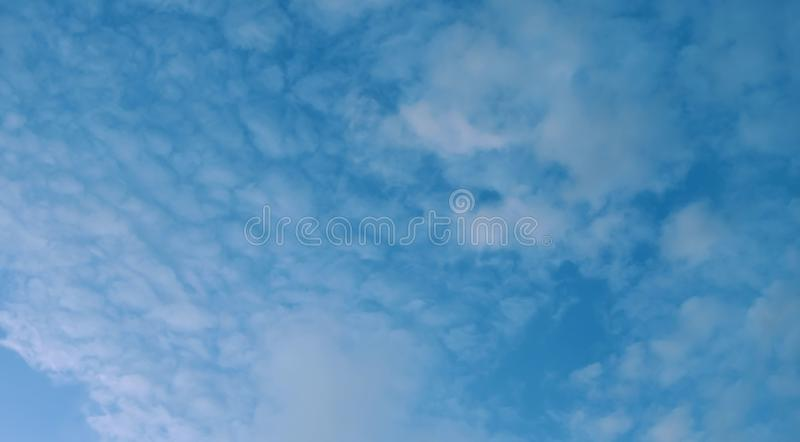 Banner Cumulus clouds of the sunset with the sunset Blue sky blurred background defocusing. Banner Cumulus clouds of the sunset with the sunset. Blue sky blurred stock photo