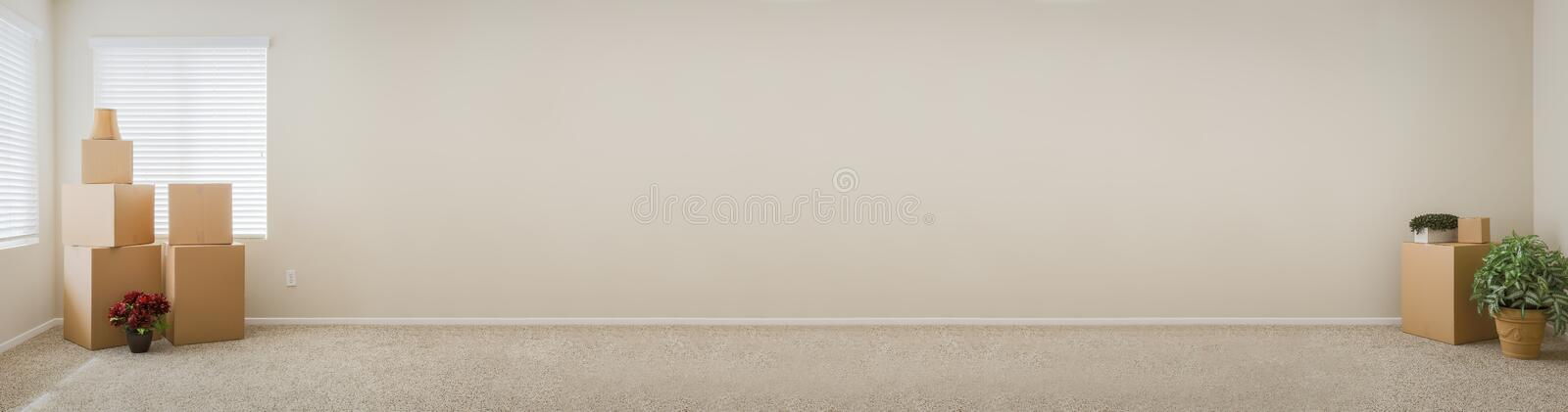 Banner of Empty Room with Blank Wall, Boxes and Plants. Banner of Empty Room with Blank Wall, Moving Boxes and Plants stock photos
