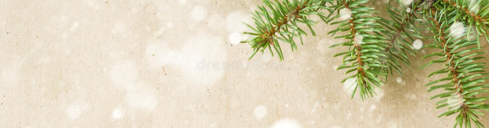 banner of Festive christmas corner with fir branches and snowflakes with snow on rustic beige background stock images