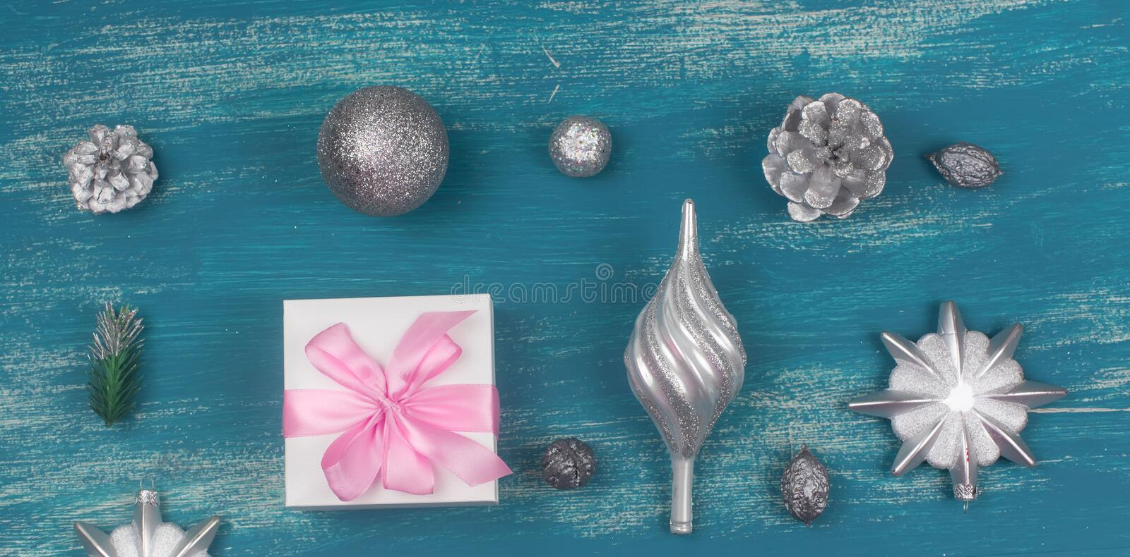 Banner Festive composition flat lay Christmas toy balls cones snowflakes silver box knolling wooden vintage background. stock photos