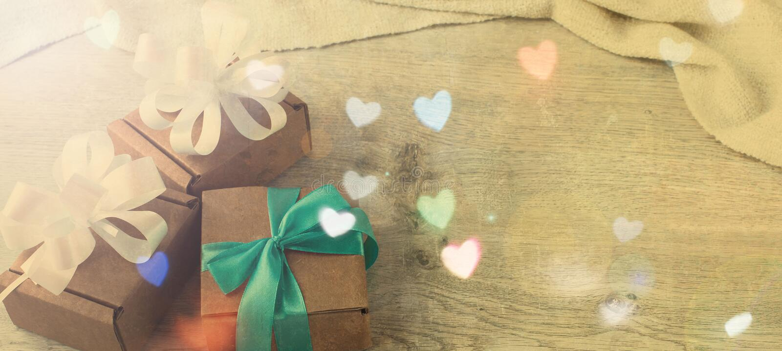 Banner Festive vintage background boxes with gifts on wooden background. Festive effects top View Flat lay royalty free stock images