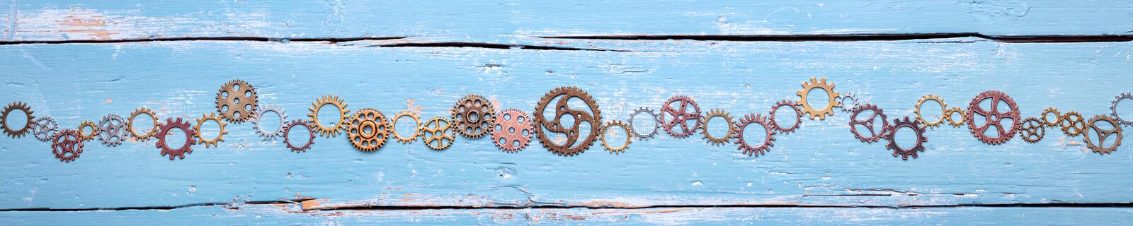 Banner, gears on blue background, concept teamwork and cohesion royalty free stock photos