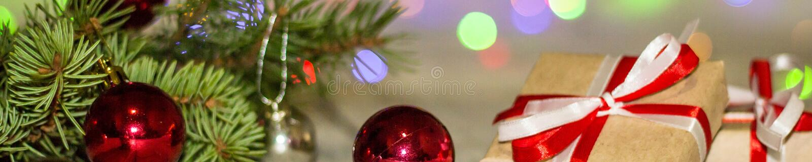 Banner of Gift boxes and colorful decorated Christmas tree on bokeh background with copy space stock photos