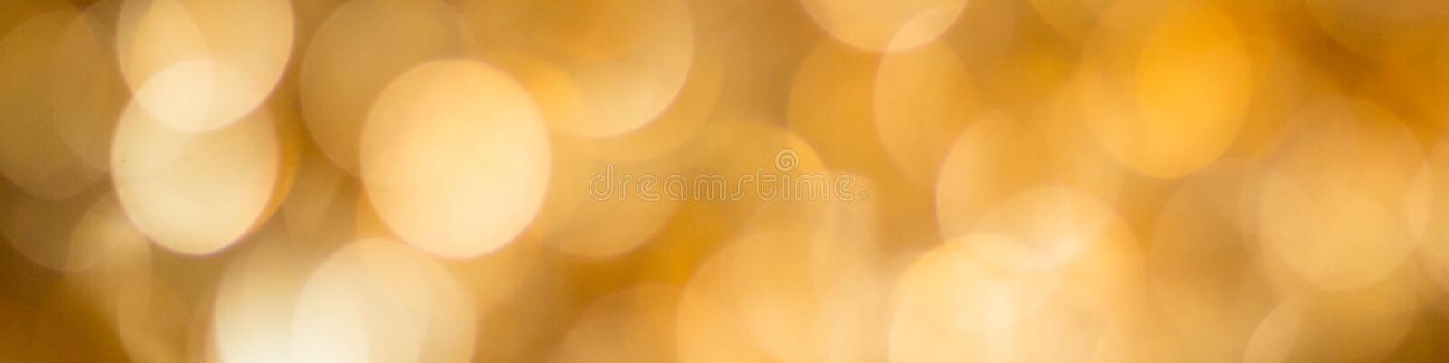 Banner of gold abstract background with bokeh defocused lights royalty free stock photography