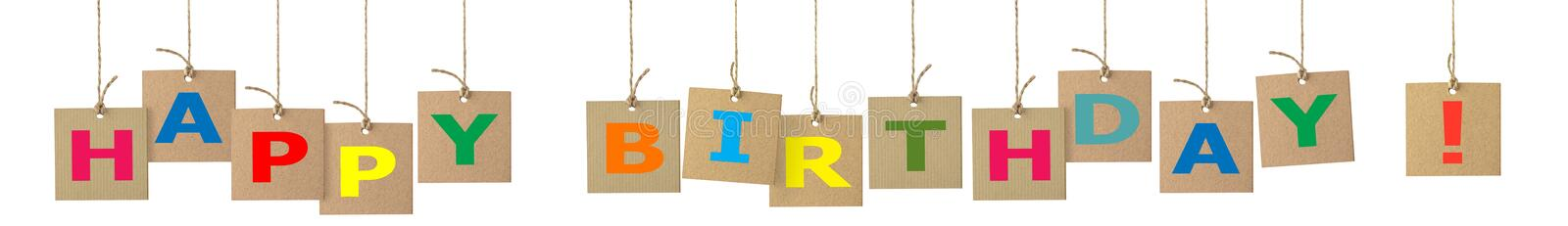 Banner with Happy Birthday Letters. On hanging cardboard labels with rope royalty free stock images