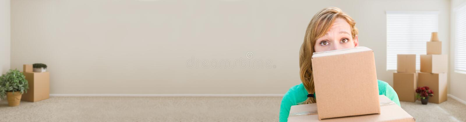 Banner of Happy Young Adult Woman Holding Moving Boxes In Empty stock photos