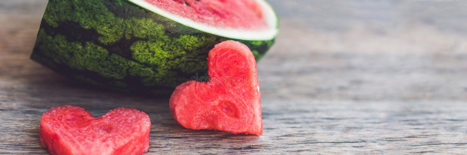 BANNER Healthy watermelon smoothie with mint, a piece of watermelon, hearts and a striped straw on a wood background Long Format. BANNER Healthy watermelon stock photography