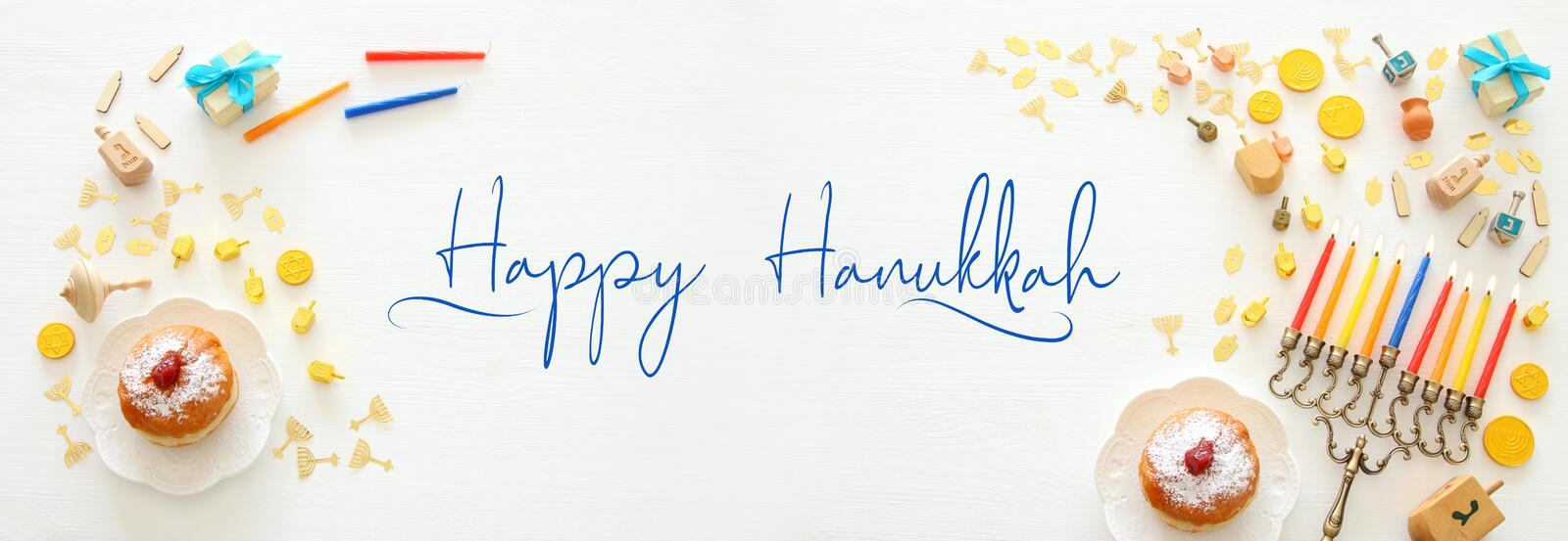 Banner of jewish holiday Hanukkah background with traditional spinnig top, menorah traditional candelabra and burning candles. Banner of jewish holiday Hanukkah stock photo