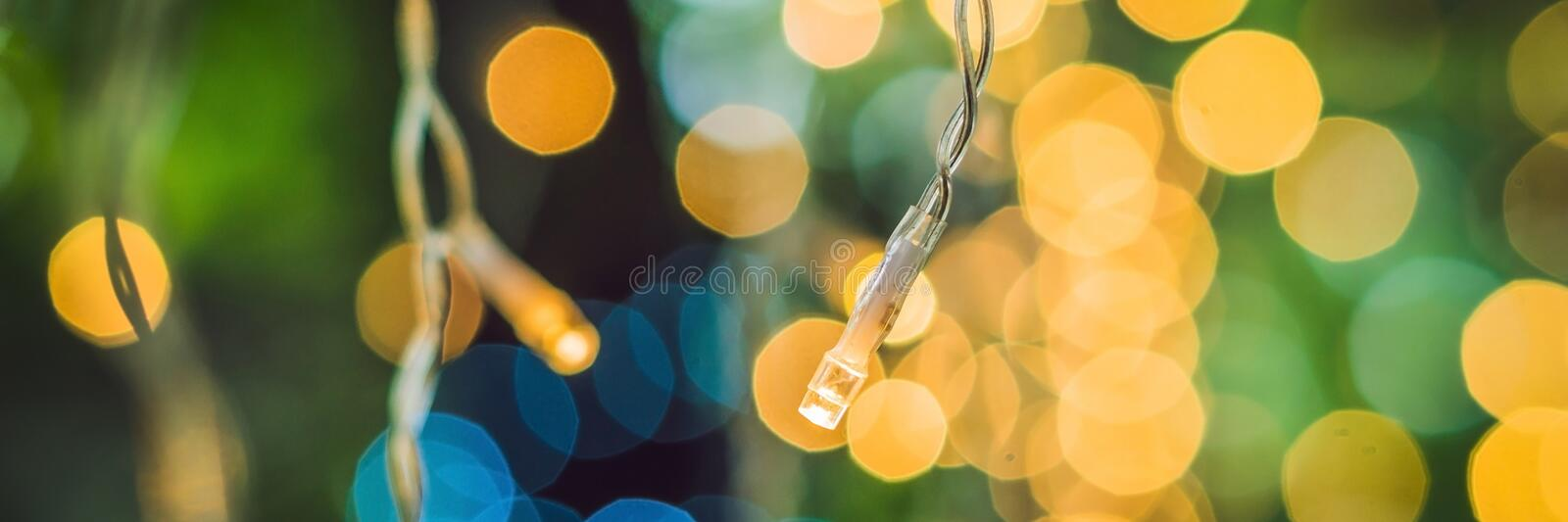 BANNER LED lights garland, colorful light bulbs on a bokeh background Long Format. BANNER LED lights garland, colorful light bulbs on a bokeh background. Long royalty free stock photography