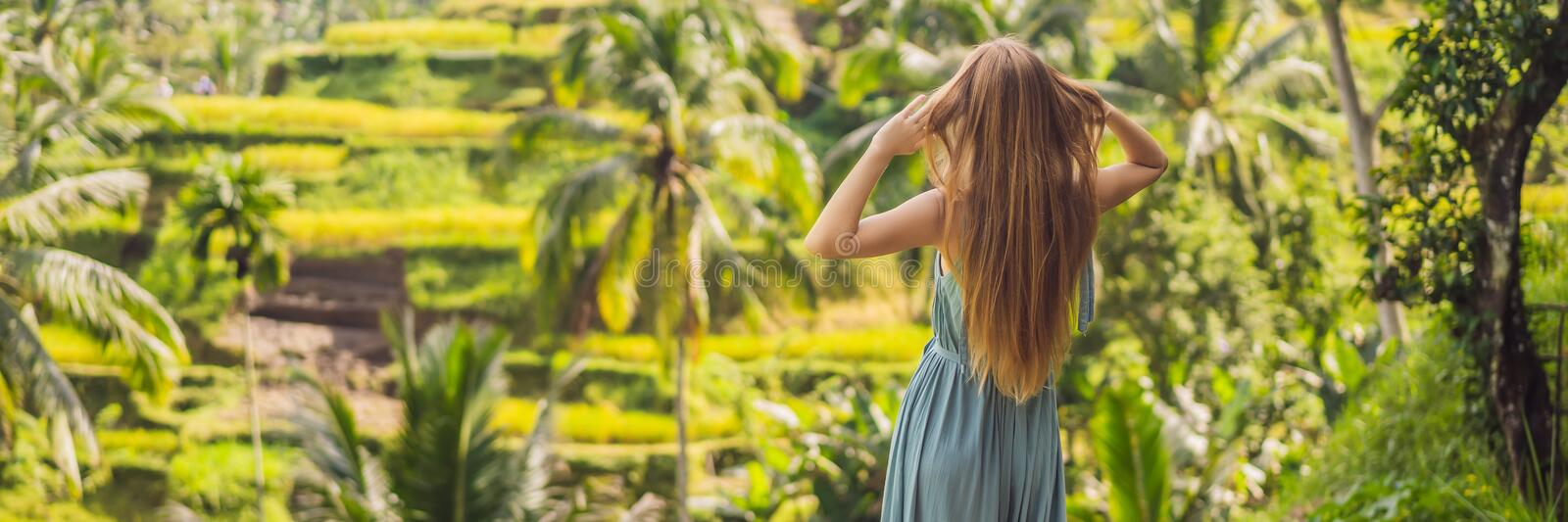 BANNER, LONG FORMAT Beautiful young woman walk at typical Asian hillside with rice farming, mountain shape green cascade royalty free stock photos