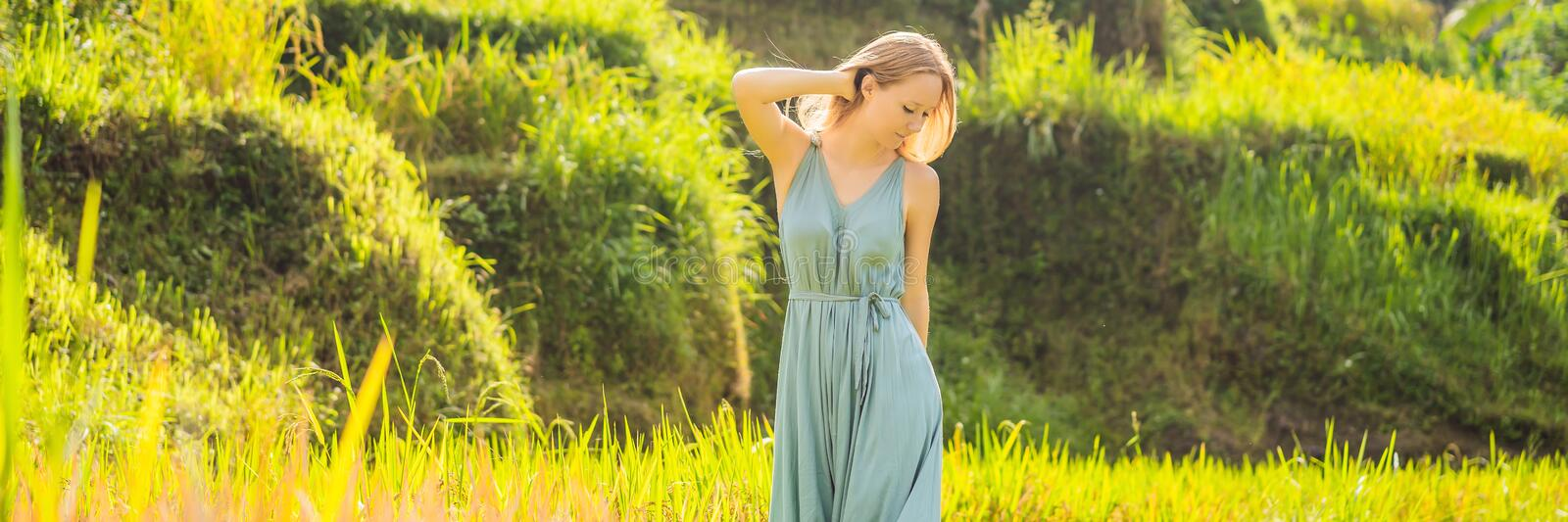 BANNER, LONG FORMAT Beautiful young woman walk at typical Asian hillside with rice farming, mountain shape green cascade stock photos
