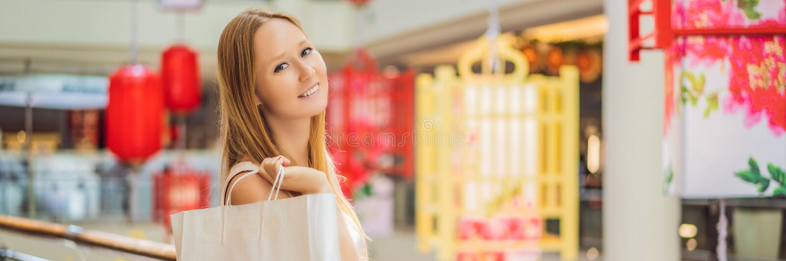 BANNER, LONG FORMAT Woman hold shopping bag against the background of Chinese red lanterns for the Chinese New Year. Big royalty free stock photos