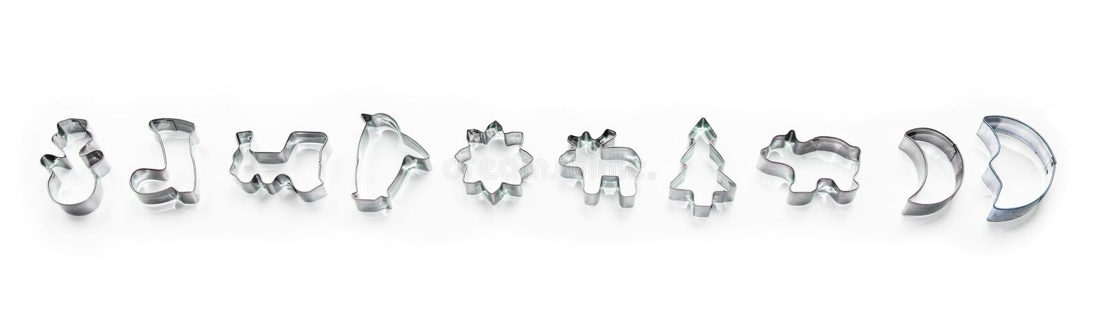 Banner made of shiny christmas silver biscuit shapes, cookie cutter isolated on white background with shadows. Banner made of shiny christmas silver biscuit royalty free stock images
