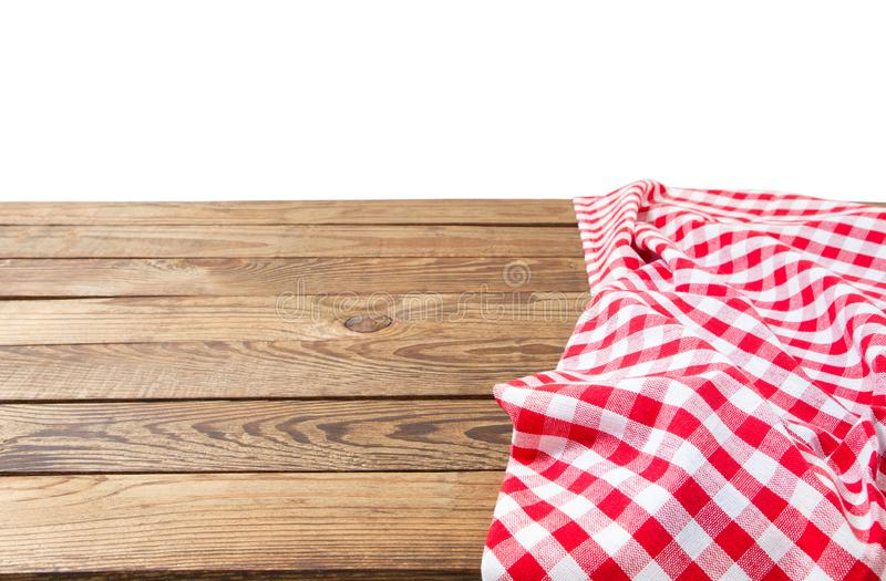 Banner of Red Checkered tablecloth top view  on white background. Brown wooden table. Selective focus. Copy space. Place. For food and drink. Picnic and stock images