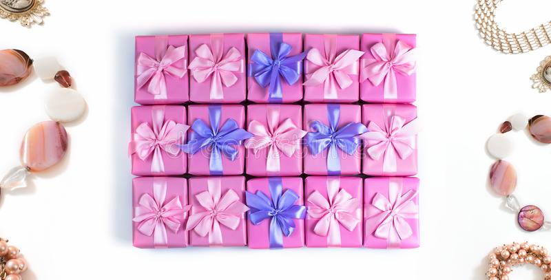 Banner Rows of boxes with gifts decoration ribbon satin bow pink fashion accessories for women jewelry pearl necklace bracelet A t stock image